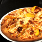 Onion Confit flatbread with Peachs and Proscuitto